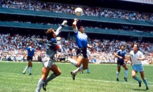 Maradonna scoring the Hand of God goal against England in the Quarter Final of the 1986 World Cup.