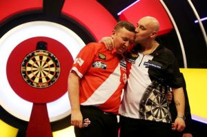 Jamie and Glenn Durrant after their second round clash at the Lakeside Word Championship 2015. www.gazettelive.co.uk